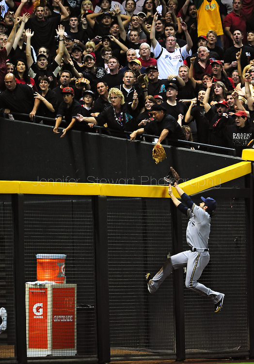 Oct. 5 2011; Phoenix, AZ, USA; Milwaukee Brewers outfielder Ryan Braun (8) attempts to catch a home run hit by Arizona Diamondbacks infielder Aaron Hill (not pictured) during the sixth inning at game four of the 2011 NLDS at Chase Field. Mandatory Credit: Jennifer Stewart-US PRESSWIRE.