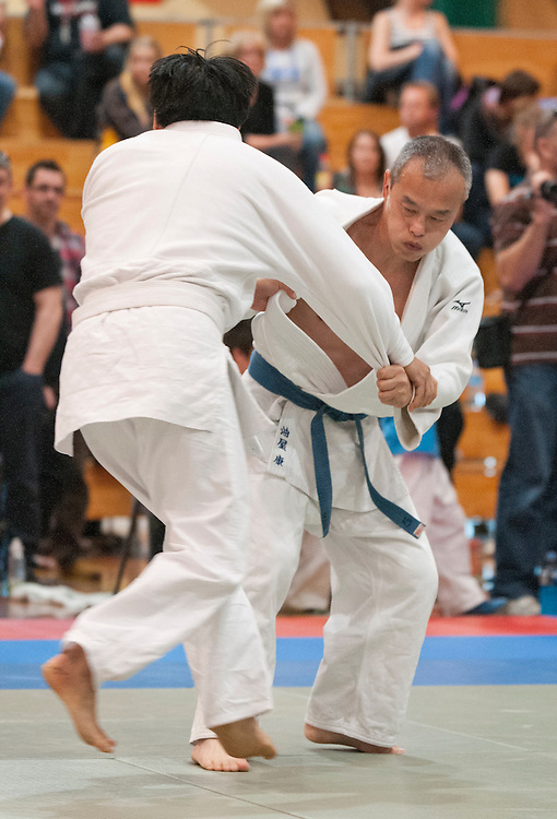 Koh Aburaya, Christchurch,  rear,  and Daryl Lim, North Harbour in their Masters  under 73kg fight final at the  2012 New Zealand Judo Championships, Christchurch, New Zealand,  Sunday 21 October, 2012. Credit: SNPA / David Alexander.