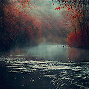 Rising fog over river Wupper on a morning in early Winter - texturized photograph