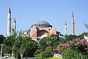 "Aya Sofya Museum in İstanbul, Turkey. In Greek, it's called Hagia Sofia, or Sancta Sophia in Latin, which means ""Divine Wisdom."" The minarets were constructed after the Islamic conquest of 1453. Emperor Justinian built the Hagia Sofia from 532 to 537 AD in Constantinople on the site of a former Hagia Sofia on the acropolis of the former Byzantium. The 102-foot diameter dome perches an amazing 180 feet above the floor (rivalling the scale of the 144-foot high and wide concrete dome of Rome's Pantheon, built earlier from 118-125 AD). An earthquake collapsed the dome after only 22 years, and it was rebuilt several times by later Byzantine emperors and Ottoman sultans. 30 million gold mosaic tiles covered the dome's interior in Byzantine times. Hagia Sofia reigned as the greatest church in Christendom for nearly 1000 years, until the Islamic conquest of Constantinople by Mehmet the Conqueror in 1453. A church with a larger dome, St. Peter's Basilica in Rome, was not built until 1506. Hagia Sofia served as a mosque from 1453 to 1935, after which Atatürk, the father of the modern Republic of Turkey, declared it a museum. İstanbul's Hagia Sofia still stands as one of the architectural marvels of the world."