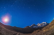 The autumn constellations of Perseus (left), Andromeda (centre) and Pegasus (right) over the peaks of the Columbia Icefields in Jasper National Park, including at right Mt. Andromeda named for the mythological princess. Taken on Sept 14, 2014 on a very clear night before moonrise. The waning quarter Moon is rising in the southeast at left. The foreground illumination of the moraines from Athabasca Glacier is from moonlight. The Andromeda Galaxy is at top centre.<br />