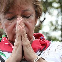 (092015  Havana, Cuba) A woman prays as Pope Francis celebrates Mass at the Plaza de la Revolucion in Havana, Sunday,  September 20, 2015. photo by Angela Rowlings.