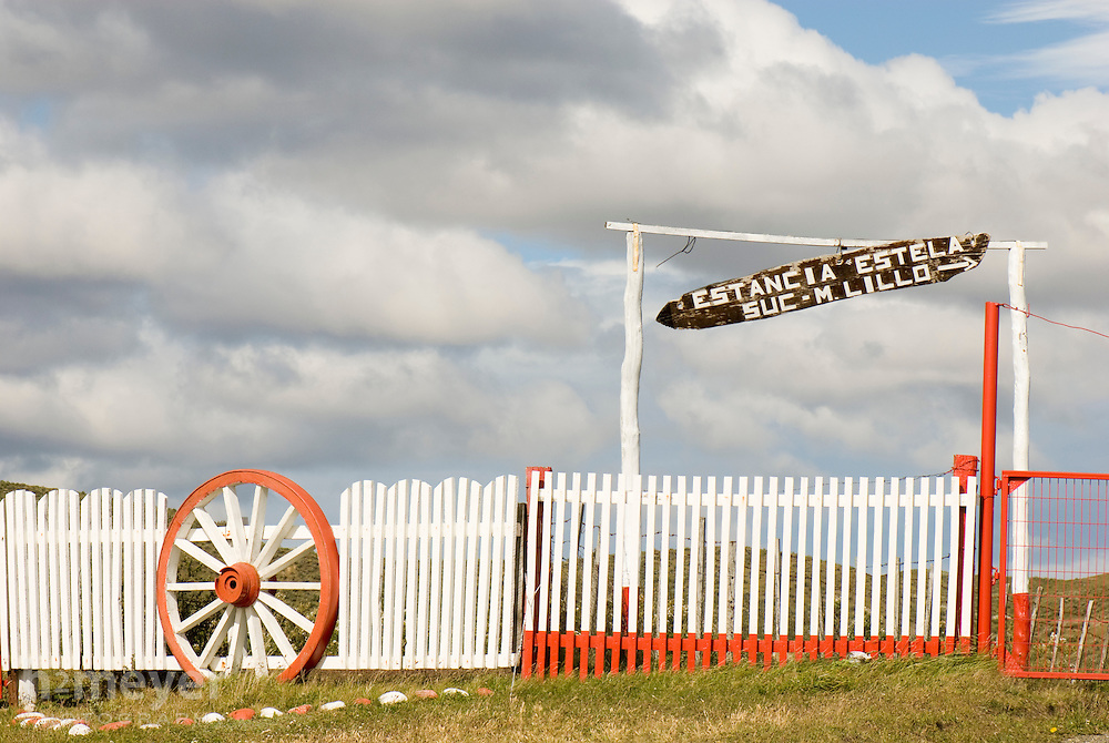 Late afternoon sun lights up the gate of Estancia Estela on the Island of Tierra del Fuego.
