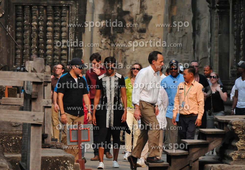 U.S. first lady Michelle Obama (C) visits the Angkor Wat Temple in Siem Reap province, Cambodia, on March 21, 2015. Michelle Obama visited Cambodia's famed Angkor Wat Temple here on Saturday afternoon during her trip to the country to promote her &quot;Let Girls Learn&quot; global education initiative. EXPA Pictures &copy; 2015, PhotoCredit: EXPA/ Photoshot/ Xue Lei<br /> <br /> *****ATTENTION - for AUT, SLO, CRO, SRB, BIH, MAZ only*****