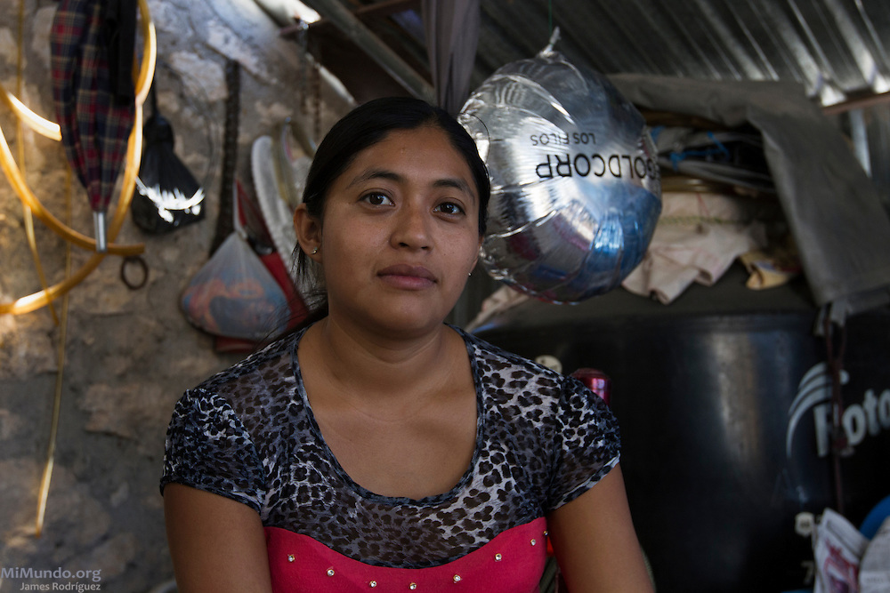 Petra Maturana, 27, sits in her patio in the Ejido of Carrizalillo. Petra's oldest son Hector, 4, was born with Craniosynostosis. Her youngest son Eric, suffers from chronic respiratory ailments. A study revealed in March 2014 by Source International concludes certain water sources used by the population in Carrizalillo contain up to 20 times the accepted levels of certain heavy metals. A town with communal land titles and a population of roughly 1,000, Carrizalillo rents its lands to Goldcorp for the operations of Los Filos open pit gold mine. Carrizalillo, Guerrero, Mexico. March 19, 2014.