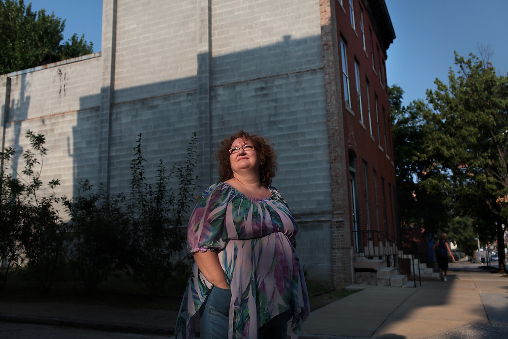 Portrait of Julie Crawford Guy outside her dream home in the Franklin Square neighborhood for the Baltimore foreclosure story on August 8, 2010. She and her husband bought the 140-year-old house which they planned to renovate but they discovered there were serious problems with the foundation. They started going deeper into debt and couldn't keep up with the mortgage. For ProPublica foreclosure story..Photographer: Melanie Burford for ProPublica.