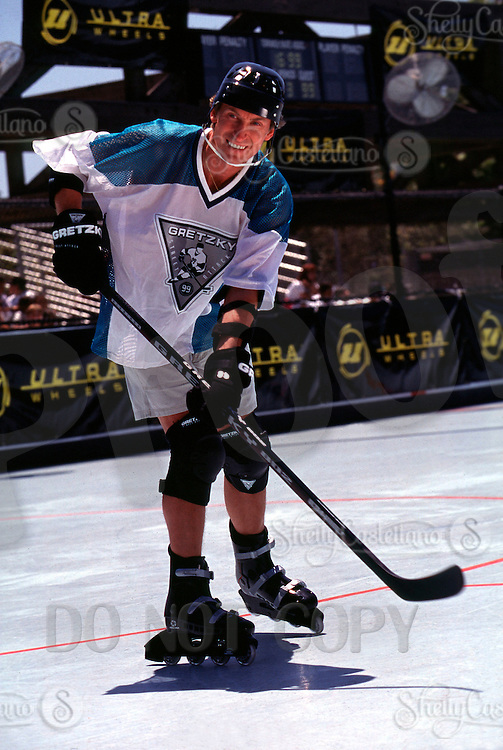 9 July 1996: NHL legend Wayne Gretzky straps on in-line roller hockey skates, custom gloves, stick and protective gear for a photo shoot with Ultra Wheels at an outdoor rink in Los Angeles, CA. EXCLUSIVE action photo of #99 playing rollerhockey. .