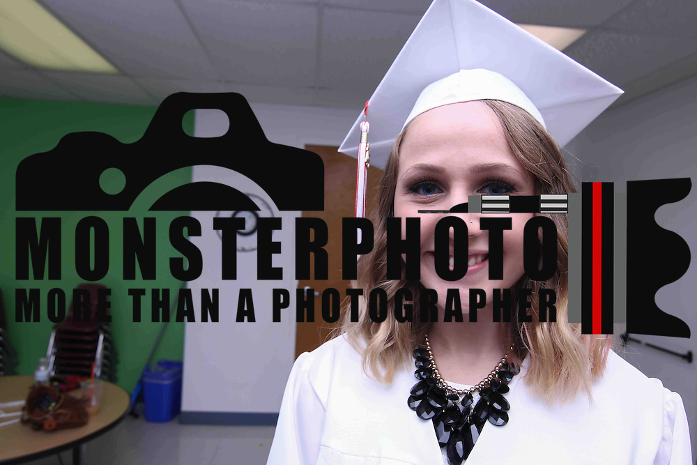 Red Lion Christian Academy Graduate Brianna Magee pose for a photo prior to commencement exercise Friday, May 29, 2015, at Glasgow Church in Bear, Delaware.