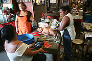 El Mercado Roberto Huembes in Managua, Nicaragua, is a large market with some 7,500 sellers and other workers. It contains many sections such as fresh fruit and veg, meat, fish, iguanas, piñatas, spices, clothes and cooked food and has its own bus station.