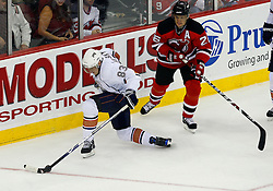 Nov 9, 2008; Newark, NJ, USA; Edmonton Oilers right wing Ales Hemsky (83) skates with the puck by New Jersey Devils left wing Patrik Elias (26) during the third period at the Prudential Center. The Oilers defeated the Devils 2-1.