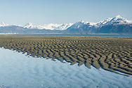 Patterns in sand at low tide in Kachemak Bay along the Homer Spit in Homer in Southcentral Alaska. Spring. Evening.