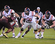 Ole Miss' Matt Hall (75), Ole Miss' Evan Swindall (56), and Ole Miss' Patrick Junen (77) vs. Mississippi State in Starkville, Miss. on Saturday, November 26, 2011.