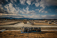 """A new """"kari-okiba"""" temporary storage spac in Minami Soma what used to be the northern limit of the original 20 km nuclear no-entry zone.  Fukushima Prefecture, Japan."""