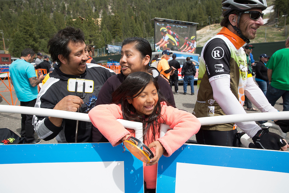 Lizabeth Cedeno, center, waits for the finish of stage five of the Amgen Tour of CaliforniaThursday, May 19, 2016 in South Lake Tahoe, Calif.