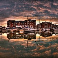 Sunset, Exeter Canal Basin, Exeter Quayside, Exeter, Devon, England.  Boats having been coming to Exeter's historic quayside for centuries.  At sunset the sky reflects on the still waters of the canal.  This is a high dynamic range image (HDR) created from multiple exposures.