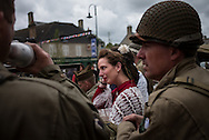 Reenactors arriving in the main square of Saint Mere Eglise