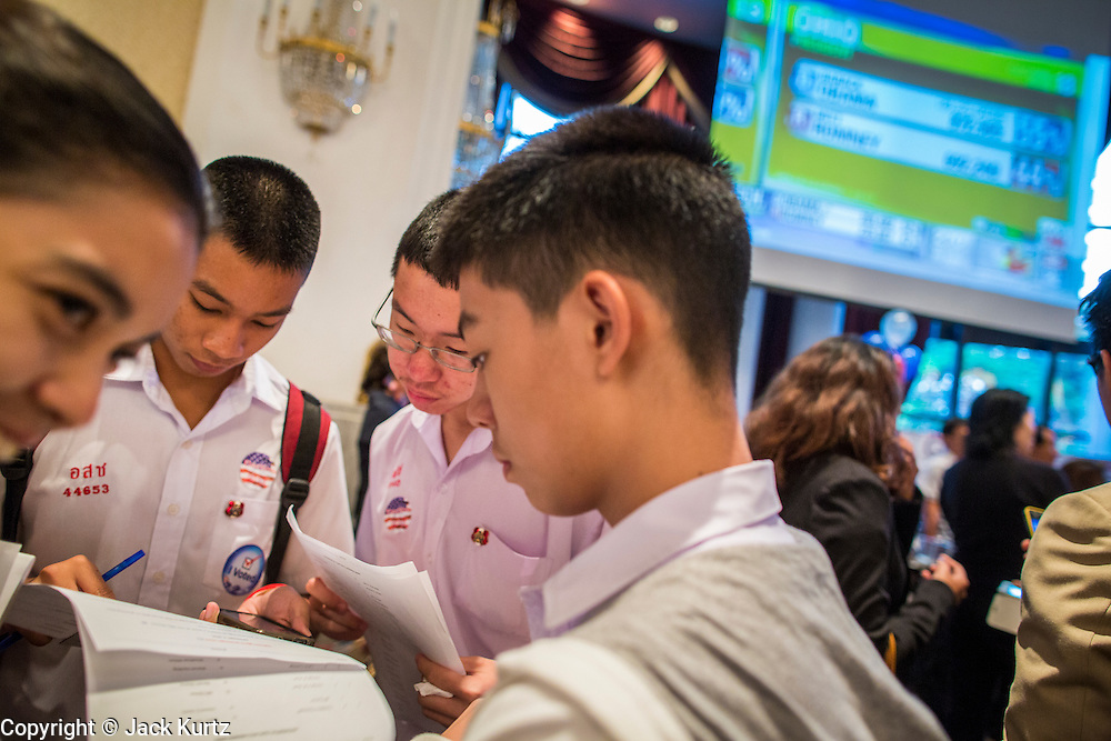 07 NOVEMBER 2012 - BANGKOK, THAILAND:   Thai high school students monitor US election results at the US Embassy's election watch party in Bangkok. US President Barack Obama won a second term Tuesday when he defeated Republican Mitt Romney. Preliminary tallies gave the President more than 300 electoral votes, well over the 270 needed to win. The election in the United States was closely watched in Thailand, which historically has very close ties with the United States. The American Embassy in Bangkok sponsored an election watching event which drew thousands to a downtown Bangkok hotel. American Democrats in Bangkok had their own election watch party at a restaurant in Bangkok.     PHOTO BY JACK KURTZ