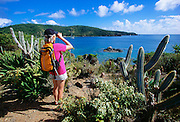 356201-1020 ~ Copyright:  George H. H. Huey ~ Hiker on the Yawzi Point Trail, looking across Great Lameshur Bay, southeast coast of St. John Island, U.S. Virgin Islands National Park.  Caribbean. Release #127