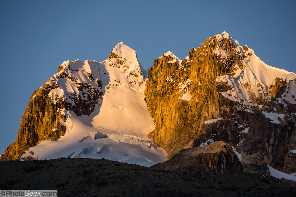 Golden sunset light shines on Nevados Puscanturpa, seen from Yanapampa campsite in Cuyoc Valley. Day 5 of 9 days trekking around the Cordillera Huayhuash in the Andes Mountains, Peru, South America.