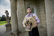 4-10-16<br /> <br /> Joe Collins of Mealy's Fine Art Auctioneers, Agents and Valuers pictured with a Victorian Taxidermy Indian Tigers Head at the sale of items from Castlemartin House, Co. Kildare - comprising fine antiques and decorative art from the wonderful private collection of Sir Anthony O&rsquo;Reilly and of Kilfane House on the instructions of the Clarke family.<br /> <br /> Picture Dylan Vaughan.