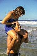 Australia, Queensland, man with woman on his shoulders.