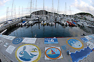 Traditional paints and drawings all boats do when entering the Horta harbour, for protection and good luck in their trans-atlantic crossings, Faial Island; Azores Islands, Portugal, North Atlantic Ocean ( sailing boats sailor ocean transatlantic )&amp;#xA;&copy; KIKE CALVO<br />
