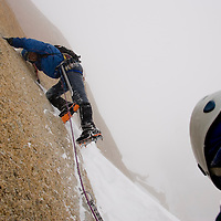 Climbers on the Arete du Cosmique in Chamonix, France.