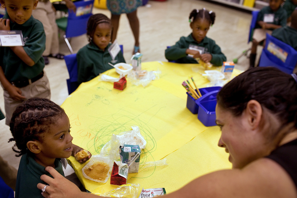 Principal Gina Ribiero, far right, in kindergarten on the first day of class at Brownsville Elementary School in Brooklyn, NY on August 15, 2011.