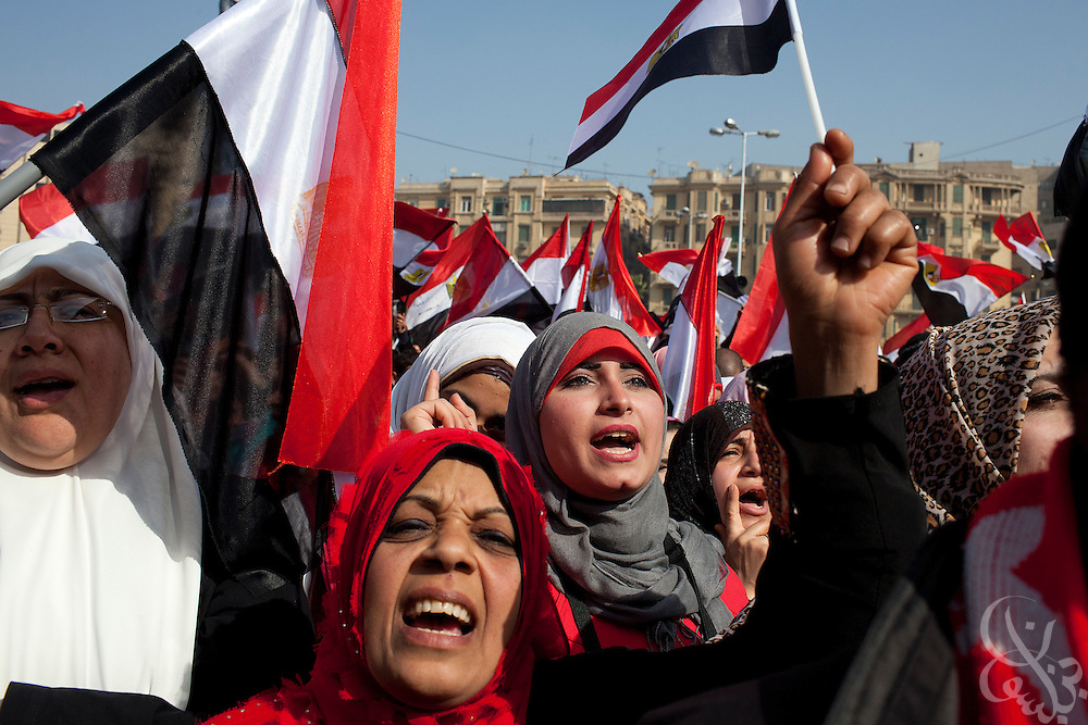 Islamist Egyptian women and children join hundreds of thousands to celebrate the one anniversary of the Egyptian revolution in Tahrir Square January 25, 2012 in Cairo, Egypt.