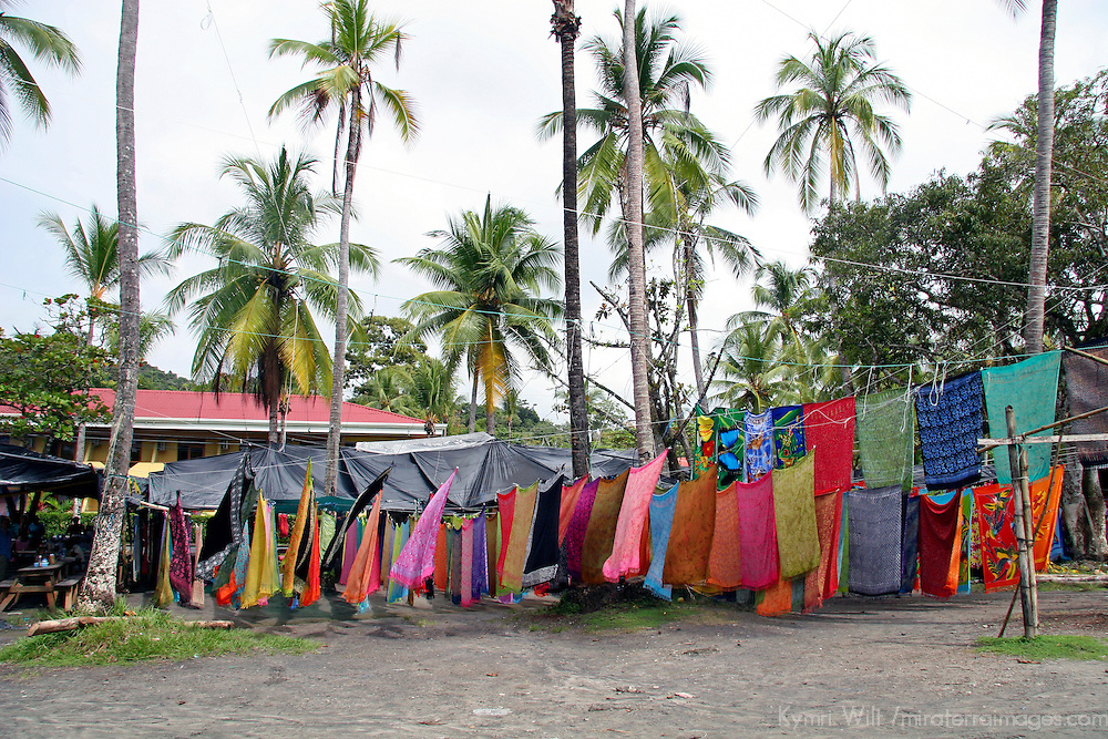 Central America, Costa Rica, Manuel Antonio. Batiks hanging along beach make for colorful souvenirs of Costa Rica.