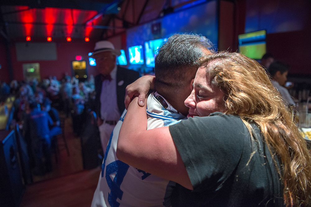 em050217k/a/Amber Trujillo hugs her husband City Councilor Ron Trujillo as the results of the soda tax election come in. They were at a party by Smart Progress New Mexico at the Boxcar in Santa Fe, Tuesday May 2, 2017. Trujillo opposed the tax. (Eddie Moore/Albuquerque Journal