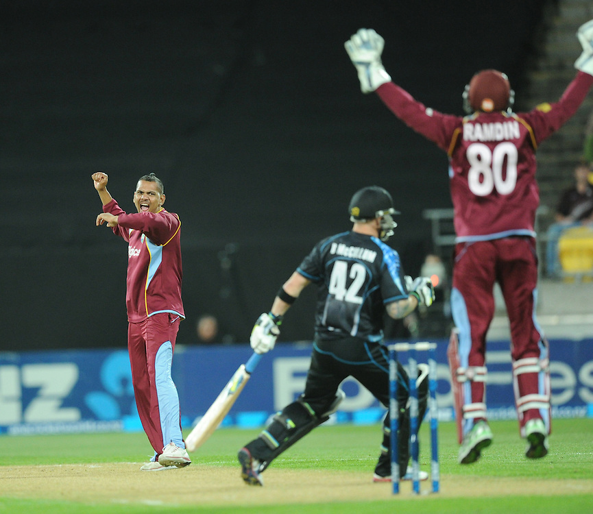 West Indies Sunil Narine, left, with Denesh Ramdin after trapping New Zealand's Brendon McCullum lbw for 17 in the second T20 International cricket match, Westpac Stadium, Wellington, New Zealand, Wednesday, January 15, 2014. Credit:SNPA / Ross Setford