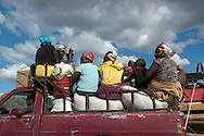 Haitian women aboard a pick-up truck take their agricultural products to market. National Highway 1, Haiti. January 21, 2008.
