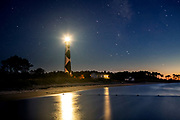 NC00882-00...NORTH CAROLINA - Cape Lookout Lighthouse and Keepers House in Cape Lookout National Seashore reflected in Bardens Inlet at twilight.
