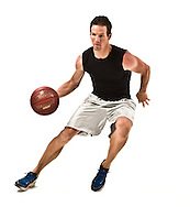 Fitness shots in studio, a man playing basketball