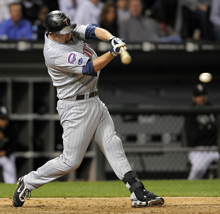 CHICAGO - SEPTEMBER 21:  Michael Cuddyer #5 of the Minnesota Twins hits an RBI single in the fifth inning against the Chicago White Sox on September 21, 2009 at U.S. Cellular Field in Chicago, Illinois.  The Twins defeated the White Sox 7-0.  (Photo by Ron Vesely)