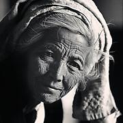 Portrait of an elderly Burmese women in a monastery in remote area of Inle Lake, Myanmar (Burma).