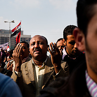 Protestors pray on Friday in Tahrir square after a week of violent clashes with security forces.