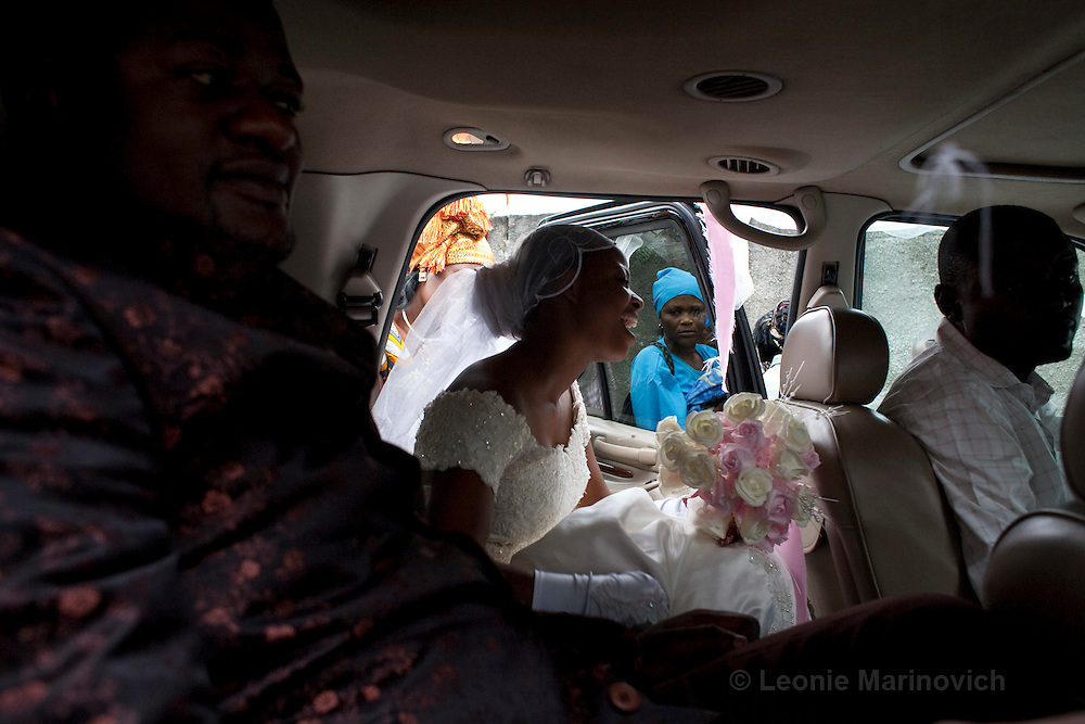 15 March 2009, Adoula Quarter, Kinshasa, DRC. The Assembly of Christ Church in Adoula host 2 services every Sunday lasting 3 hours each and hosting 10,000 people at a time. On this particular Sunday, a couple was getting married and the whole community gathered to watch the spectacle. This wedding amongst the elite of Kinshasa became a must-see event in the working-class neighbourhood of Adoula. After the final completion of the paperwork, the couple leave to go and change and prepare for the reception to be held later that day, and surely lasting into the small hours of the morning.