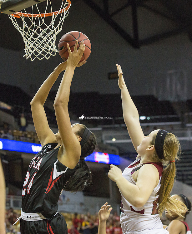 Lisa Johnston | lisajohnston@archstl.org  | Twitter: @aeternusphoto  Incarnate Word Acadamy's Napheesa Collier shot a rebound in the first half of the Class 4 Girls Basketball State Championship game between Incarnate Word Academy Red Knights and MICDS Rams.  Incarnate Word Academy won their third Red Knight championship with a score of 60 - 27.
