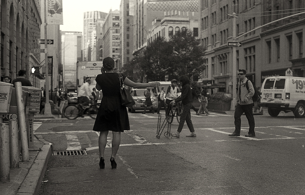 Lady in street hailing a cab. www.andersonsmithphotography.net