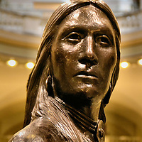 Oklahoma State Capitol Building American Indian Warrior Statue in Oklahoma City, Oklahoma<br /> In 2002, when the dome was added to the 1917 Oklahoma State Capitol, a 22 foot, 4,000 pound bronze statue was placed on top. This nine-foot replica of &ldquo;The Guardian&rdquo; is on the second floor of the rotunda. It is a somber remembrance of the &ldquo;Trail of Tears&rdquo; when five Indian tribes were removed from their homelands in the 1830s. The artist was Enoch Haney. He was a multi-term legislator and the grandson of a Seminole chief.