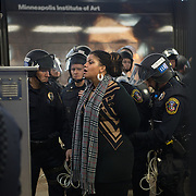 Black Lives Matter leader Nicque Mabrey, is arrested by Bloomington police after they pushed protesters out of the airport and back onto the light rail platform at the Minneapolis-St. Paul International Airport's Terminal 2 during a day of protests on December 23, 2015. Officers had issued warnings that those who did not depart on one of the two trains in the station would be arrested. <br /> <br /> Photo by Angela Jimenez for Minnesota Public Radio www.angelajimenezphotography.com