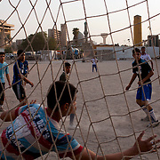 Iraqi boys play soccer in a dusty sand lot in Baghdad, Iraq August 26, 2010.   .