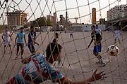 Iraqi boys play soccer in a dusty sand lot in Baghdad, Iraq August 26, 2010.   .