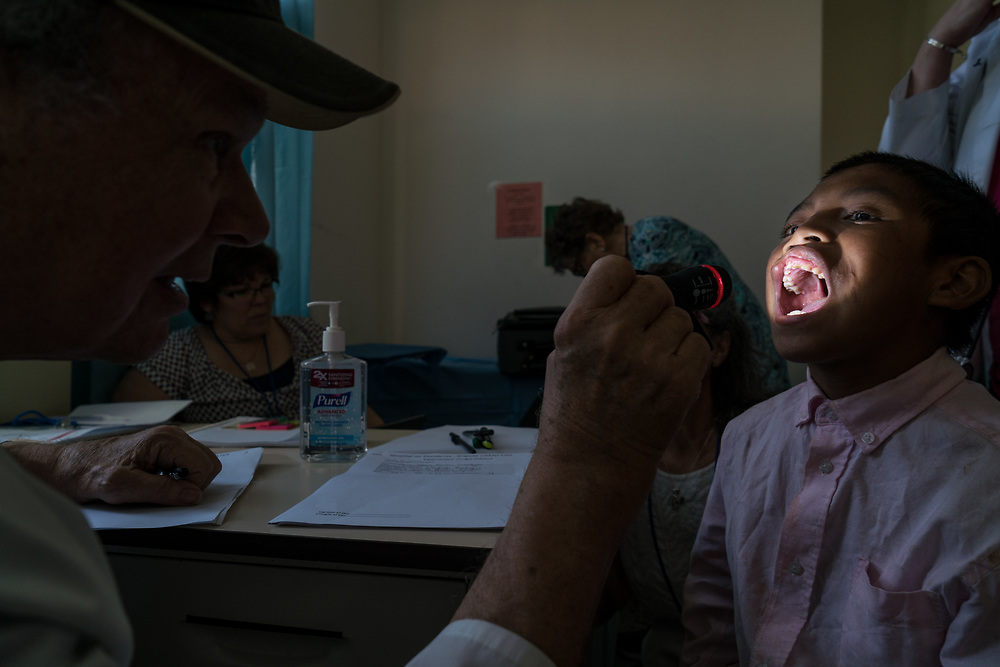 CAMO volunteer doctor Lester Mohler conducts consultations on Fernando Diaz Orellana, 11, at Occidente Hospital in Santa Rosa de Copan, Copan, Honduras on Feb. 19, 2017. Photo Ken Cedeno