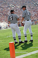 7 October 2006: Side Judge Brad Blenn discusses a play near the end zone with Head Linesman Jim Wharrie at the NCAA College Football Pac-10 USC Trojans 26-6 win over the Washington Huskies at the LA Coliseum during a sunny saturday game in Los Angeles, CA.<br />