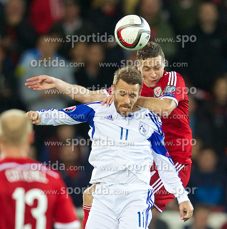13.10.2014, City Stadium, Cardiff, WAL, UEFA Euro Qualifikation, Wales vs Zypern, Gruppe B, im Bild Wales' James Chester in action against Cyprus';s Nektarios Alexandrou // 15054000 during the UEFA EURO 2016 Qualifier group B match between Wales and Cyprus at the City Stadium in Cardiff, Wales on 2014/10/13. EXPA Pictures &copy; 2014, PhotoCredit: EXPA/ Propagandaphoto/ David Rawcliffe<br /> <br /> *****ATTENTION - OUT of ENG, GBR*****