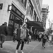 2017 MARCH 05 - Man at corner of Pine St at 4th Ave near Emerald City Comicon, downtown, Seattle, WA, USA. By Richard Walker