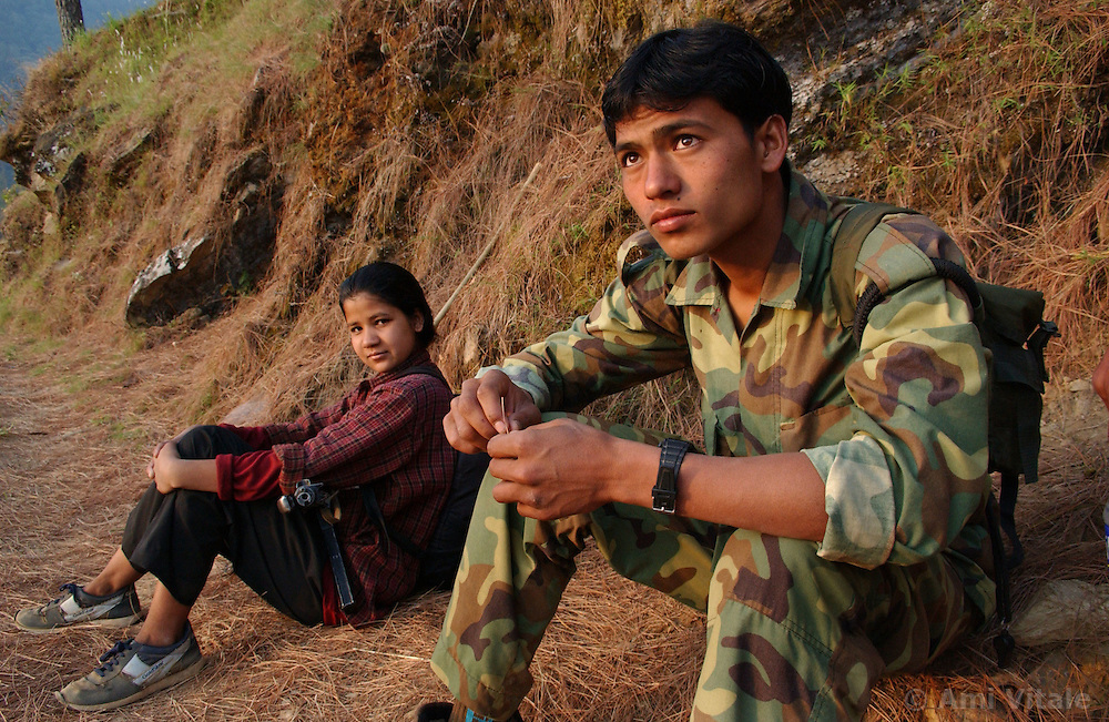 "RUKUM DISTRICT, NEPAL, APRIL 21, 2004:  Maoist insurgents walk through the mountains to a mobile training camp in Rukum district April 21, 2004.    Analysts and diplomats estimate there about 15,000-20,000 hard-core fighters, including many children and women, backed by 50,000 ""militia"".  In their remote strongholds, they collect taxes and have set up civil administrations, and ""people's courts"" to settle rows. They also raise money by taxing villagers and foreign trekkers. Though young, they are fearsome fighters and  specialise in night attacks and hit-and-run raids. They are tough in Nepal's rugged terrain, full of thick forests and deep ravines and the 150,000 government soldiers are not enough to combat this growing movement that models itself after the Shining Path of Peru. (Ami Vitale/Getty Images)"